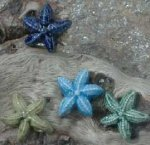 Starfish  18mm; hole thru one arm; colors: green,  lt. blue, navy, olive; $1/pair; $5/random dozen; $6/choice dozen
